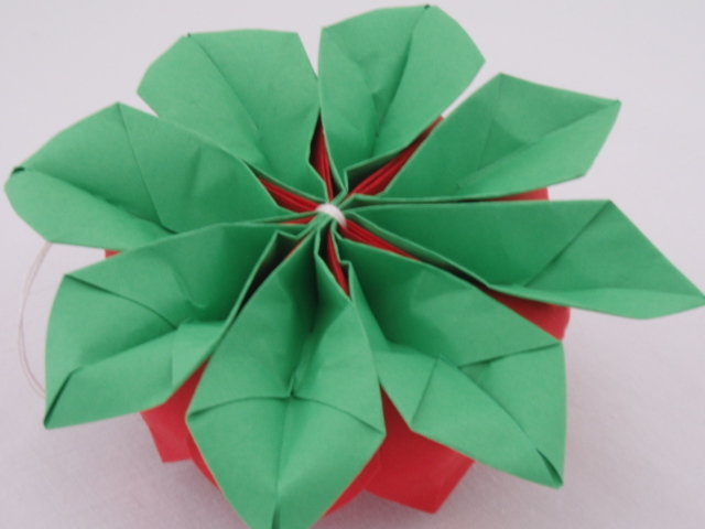 How to fold a lotus flower a bookmark or personal note can be attached to the finished lotus flower dont forget to make it a positive message because thats the only way the flower mightylinksfo